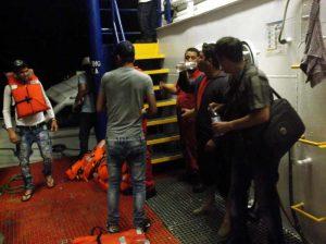 Rescued crew boarding R/V Proteus